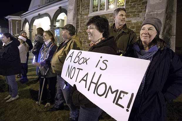 Patty Johnson, far right, her husband, Neal, and daughter, Rebecca, bring awareness to the issue of homelessness during the 2015 Lewiston-Auburn Homeless Memorial Vigil in Lewiston. PHOTO CREDIT: SUN JOURNAL, 2015.
