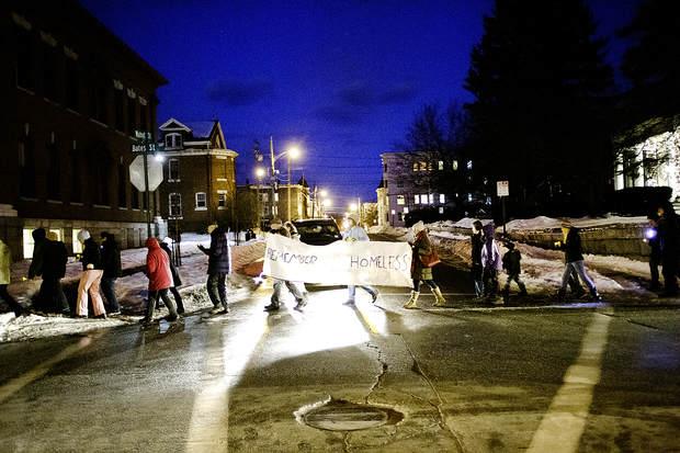 Participants cross Walnut Street during the Lewiston-Auburn Homeless Vigil in Lewiston on Wednesday.